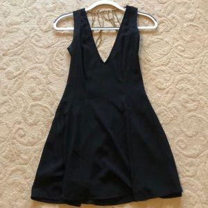 Worn once Tobi black dress. Beautiful back